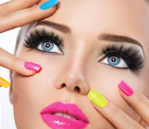 Beauty Girl Portrait with Vivid Makeup and colorful Nail polish.